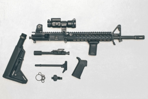 Black Rifle parts on white backdrop, AR-15 parts, AR-15 Rifle, disassembled